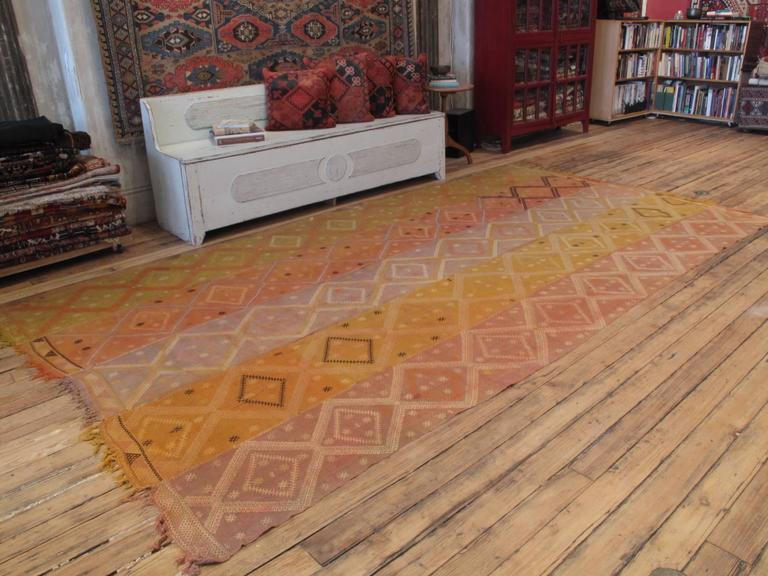 A beautiful old tribal flat-weave from Eastern Turkey, originally woven as a wall hanging or tent divider, consisting of five narrow panels with brocaded motifs. The colors have faded with age and use and there are minor losses on the edges, but the