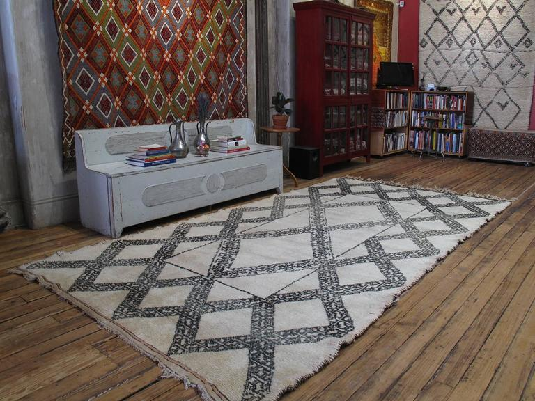 A great old Moroccan Berber rug from the Middle Atlas Mountains, featuring a very unusual design, a unique and refined interpretation of the Classic diamond grid. Though it resembles the work of the famed Beni Ouarain, it was probably woven by the
