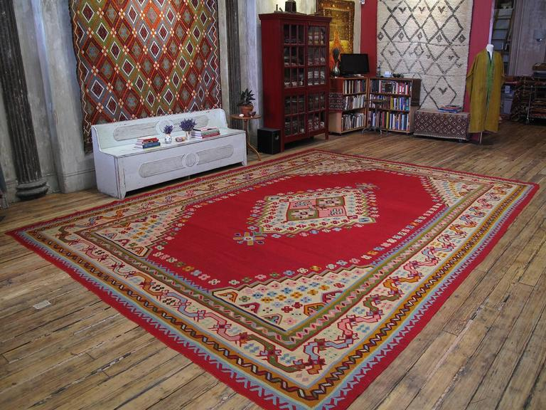 An impressive antique Turkish Kilim of large size, woven in the Oushak region of Western Turkey. In near perfect state of preservation with brilliant colors, this Kilim is contemporary with the many antique Oushak carpets woven at end of the 19th