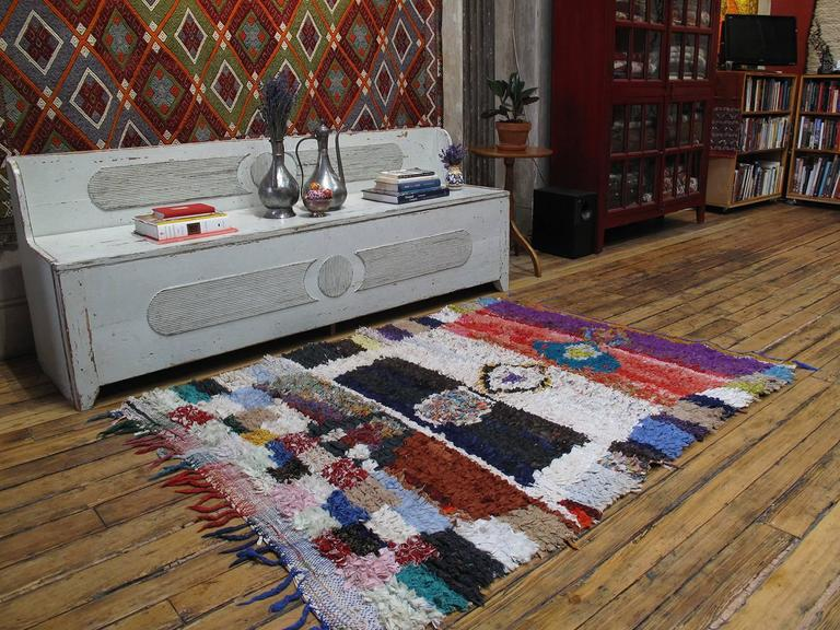 A Moroccan rug, woven entirely with cut-up pieces of fabric from old clothes, boucherouite means rag or torn cloth in Moroccan Arabic. A relatively recent phenomenon, such weavings are products of socio-economic changes in Moroccan society, with