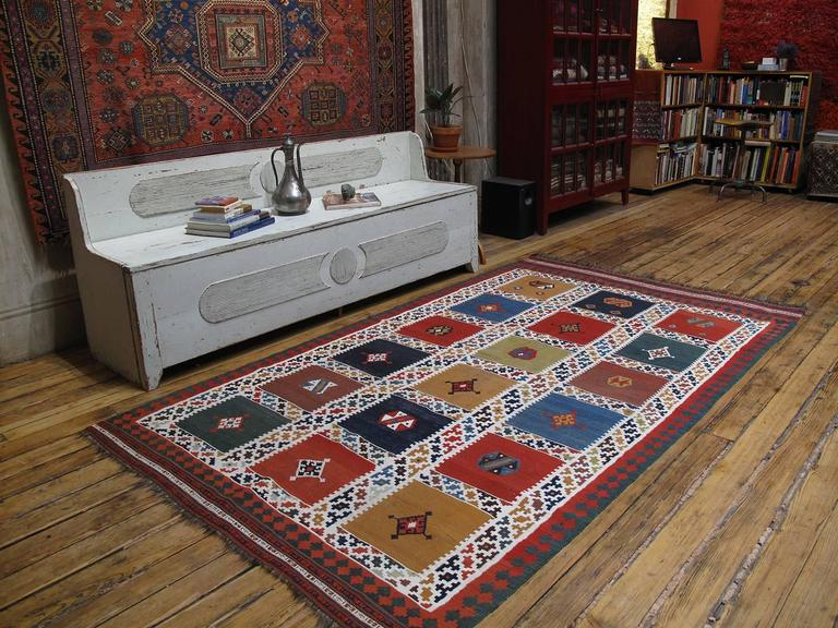 A lovely antique tribal Kilim from Southwest Iran (Persia), by the Qashqai, a Turkic speaking confederation of tribes, who are very prolific weavers. This is one of the classical designs in Qashqai kilims, executed in a great range of
