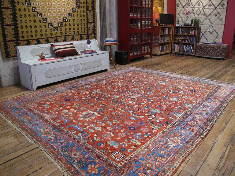 Antique Heriz carpet or rug. Woven in Northwest Iran since the end of the 19th century, Heriz carpets have been a familiar fixture of American and European interiors ever since. This is a nice example of the type, with an appealing color palette
