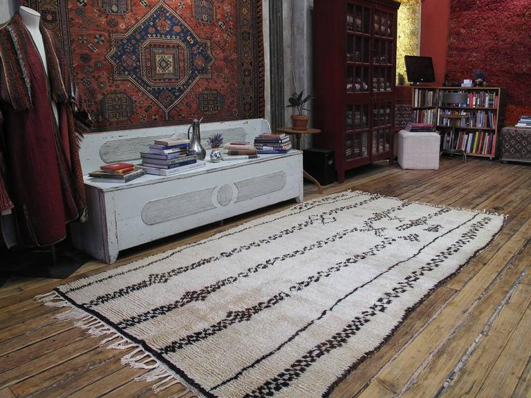 Exceptional Azilal Berber Moroccan rug. An old Moroccan Berber rug from the Azilal province in the Central High Atlas Mountains. Generous proportions and high density weave for this type of rug.  This part of Morocco remains a prolific center of
