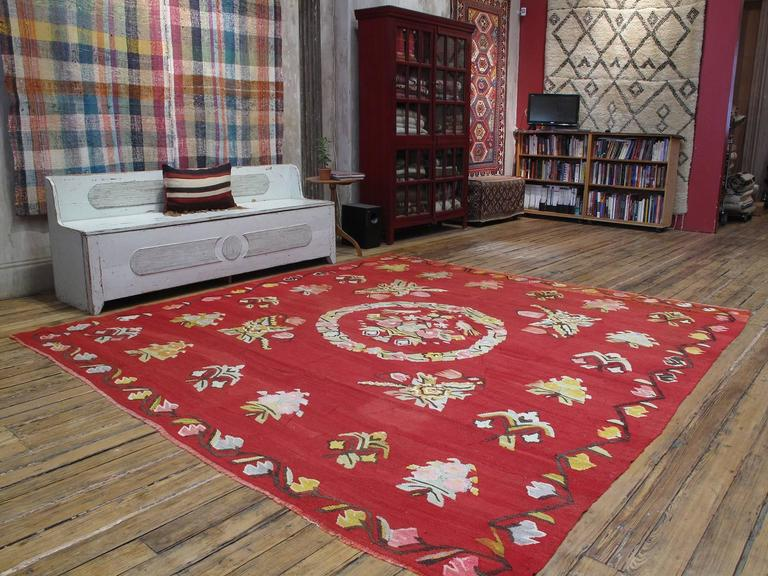 A very charming Turkish village Kilim in large format. Note the bird's nest in the centre, and the weaver's name and date on the upper right corner.