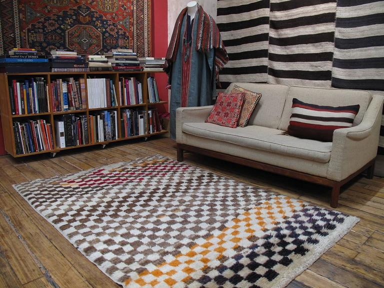 """A very high quality example of the thick fleece-like rugs known as """"Tulu"""", meaning long haired in Turkish. Woven for domestic use, to provide warmth and comfort for the family, they often feature simple geometric designs and very little color other"""