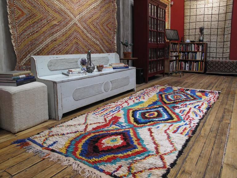 A striking Moroccan Berber rug from the Azilal province in the Central High Atlas Mountains with a bold design, vibrant colors and larger-than-usual size.  The rugs of this remote region have remained a relative secret until recently. The area