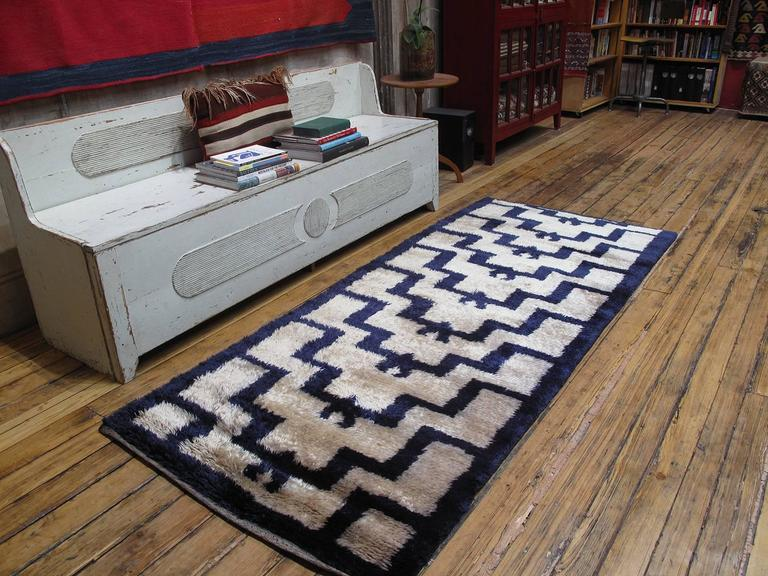 "A very good example of ""Tulu"" style weaving from Central Turkey, featuring an archaic rendition of the well-known ascending arches design, attributed to the region around Karapinar. The rug was woven with top quality angora (mohair) that has"