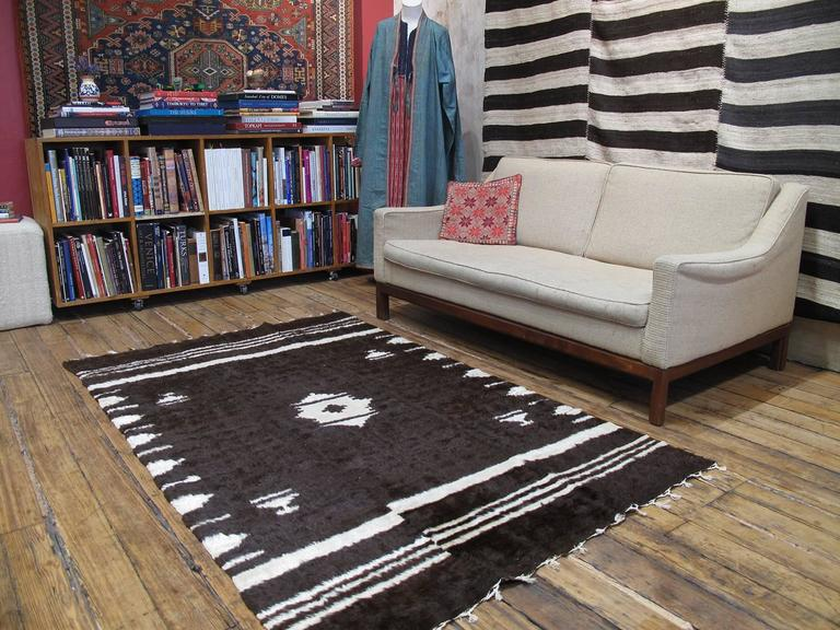 An old blanket from Eastern Turkey, woven with the fine, soft hair of the indigenous angora goat, better known as mohair. An older example, woven in three narrow panels. Can be used on the floor in low traffic, but perhaps better as a wall hanging.