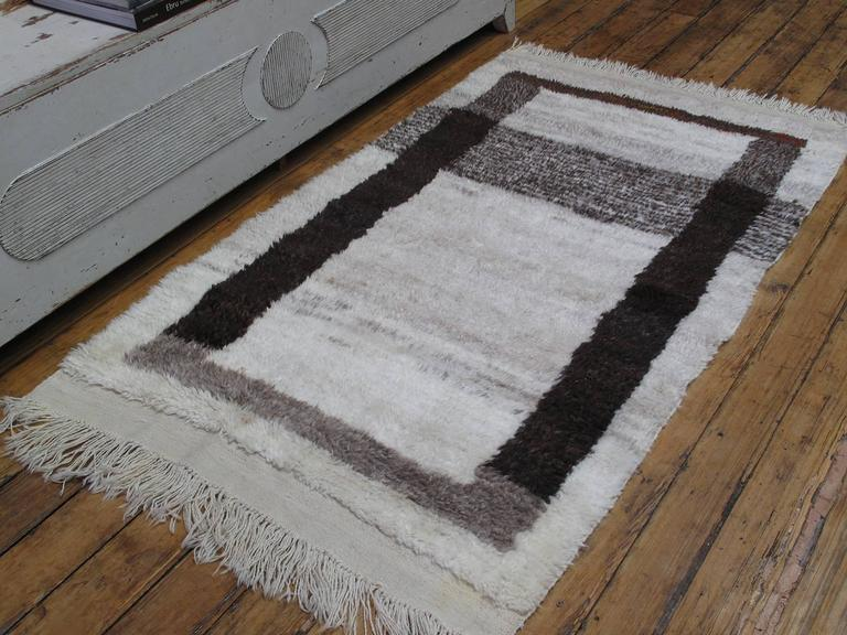 A small shaggy village rug from Central Turkey, woven with hand-spun wool in natural ivory and browns, creating a unique graphic image.