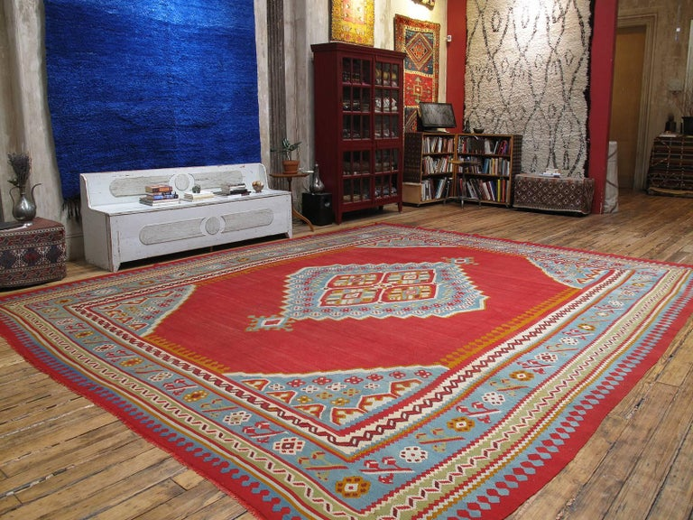 A large format antique kilim, woven in the Oushak region of Western Turkey, displaying the classic central medallion design and color palette. Such kilims were contemporary with the many antique Oushak carpets woven at end of the 19th century to