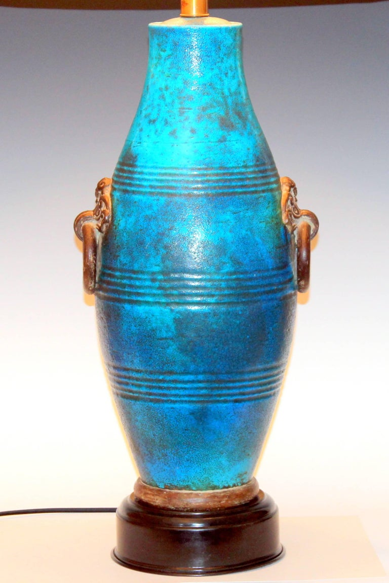 Large vintage Zaccagnini lamp in mottled turquoise glaze with big faux-iron Ming style ring handles, circa 1950s. New 3-way socket and nylon wiring. 38