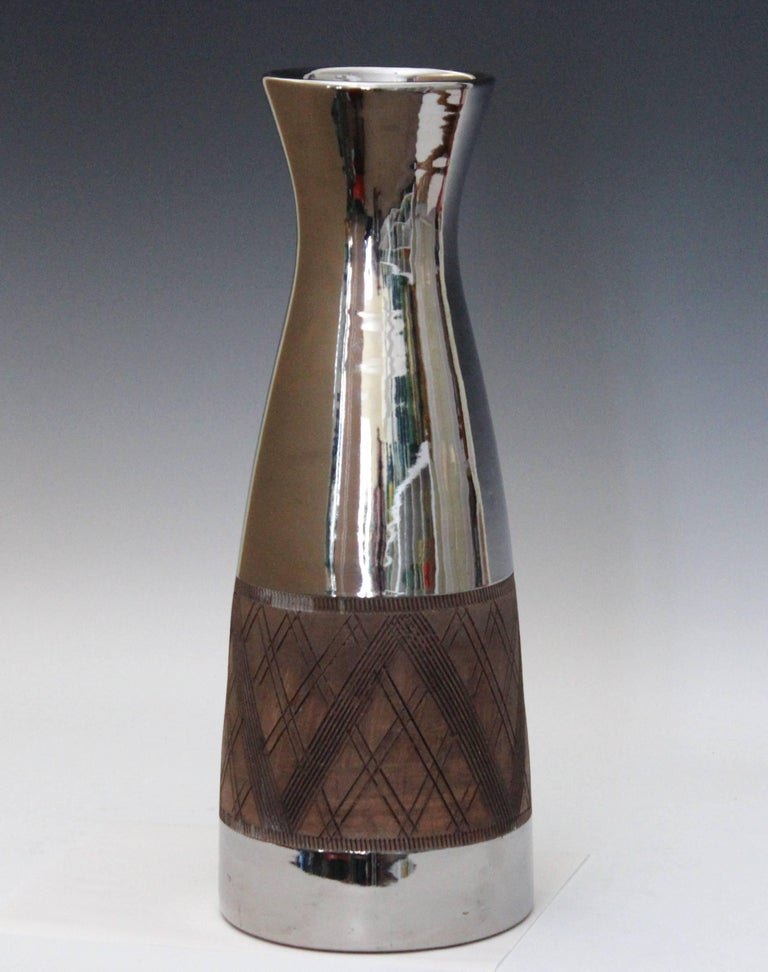 Big, sleek Bitossi pottery vase in lustrous platinum glaze, circa late 1950s-early 1960s. Hand turned with red clay and with incised cross hatching between gear tooth bands. Bitossi inventory label on base. Measures: 17