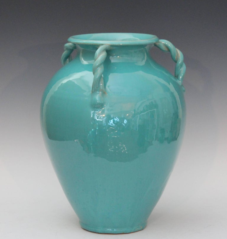 Large royal crown vase in turquoise glaze with three rope twist handles, circa 1940. Measures: 13 1/2