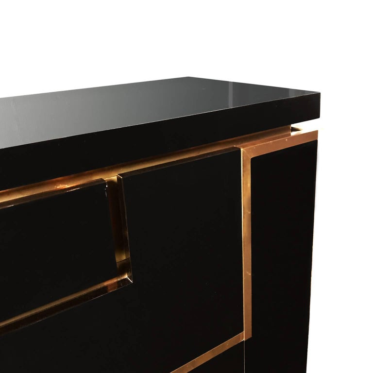 Black lacquer and brass sideboard by Jean Claude Mahey, French, 1970s.