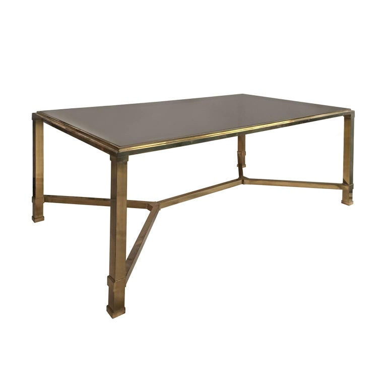 1970s Rectangular Brass and Smoked Glass Coffee Table with Brass Stretcher  For Sale