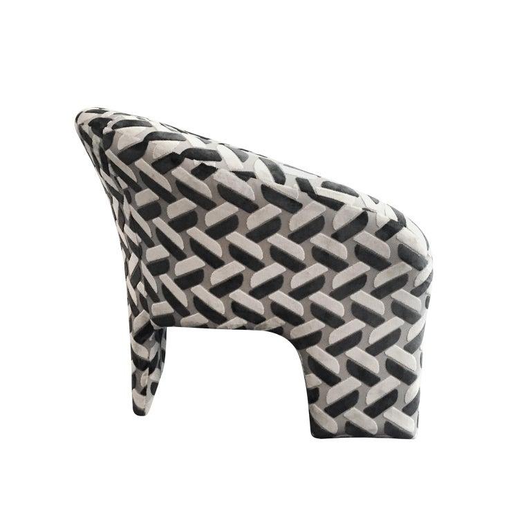 Tripod arm chair upholstered in raised contrast velvet. USA, 1970s.