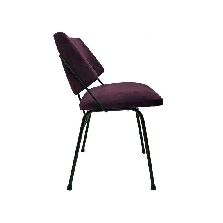 Blackened metal occasional chair with angled back and purple velvet upholstery. France, 1960s.  Pair available, priced individually.