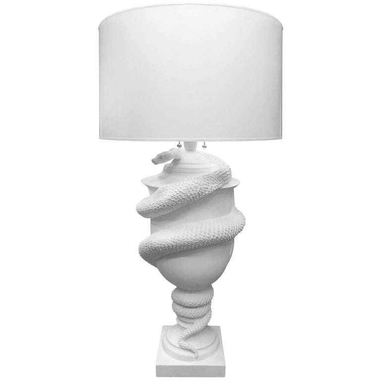 FLAIR exclusive - Grande urn with serpent table lamp in white plaster, handcrafted by George Sellers.  Dallas based sculptor George Sellers studied in Italy, where he was trained in the traditional methods by a master carver. He creates seductively