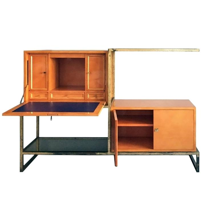 Exceptional lacquer and gilt iron secretary cabinet by Roger and Robert Thibier.  Executed in the 1960's as a custom commission, this exceptional piece features two orange lacquered cabinets housed in a gilt iron metal structure with two glass