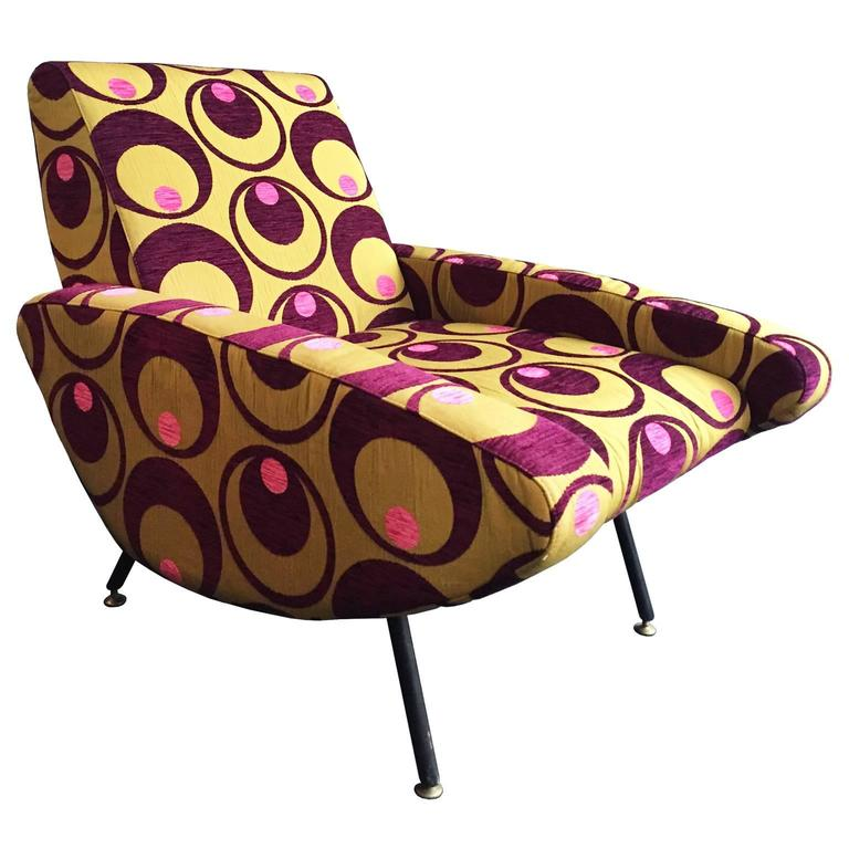 Vintage curved armchair in embroidered pop upholstery with metal legs.