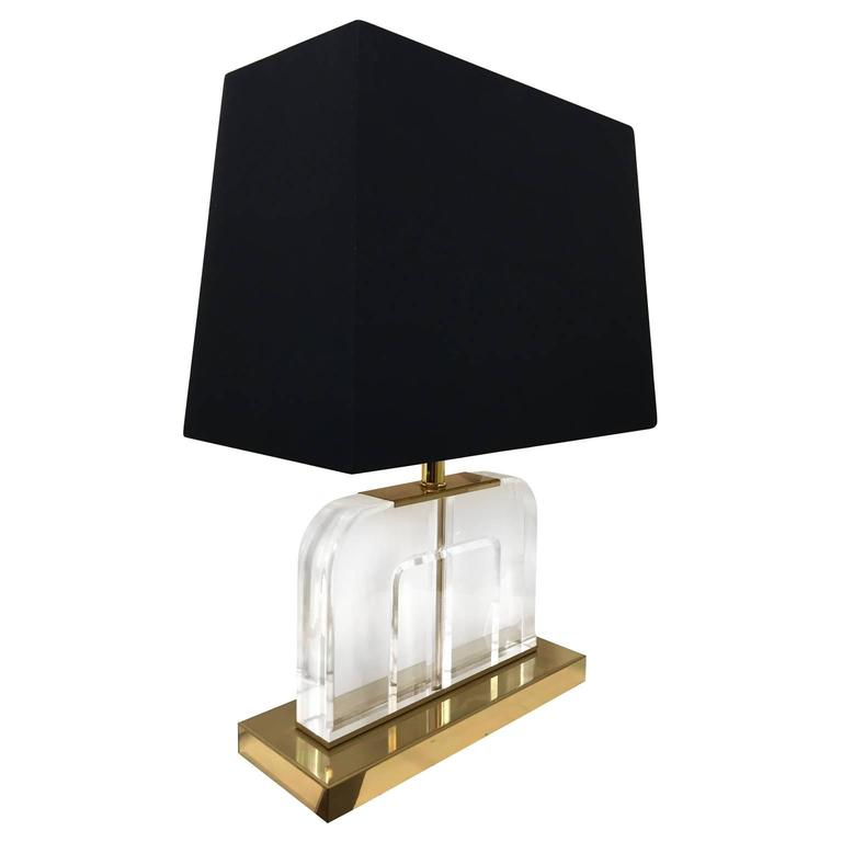 Vintage curved Lucite table lamps on brass base.   Pair available, priced individually.