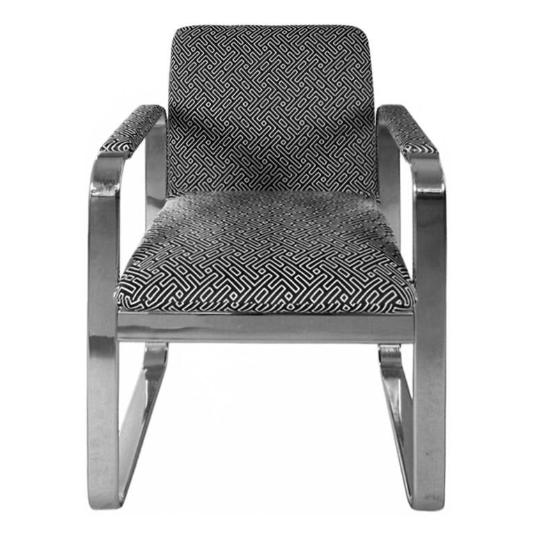 Chrome armchair with rounded rectangular frame, newly upholstered in a black and white geometric cotton. USA, 1970's.