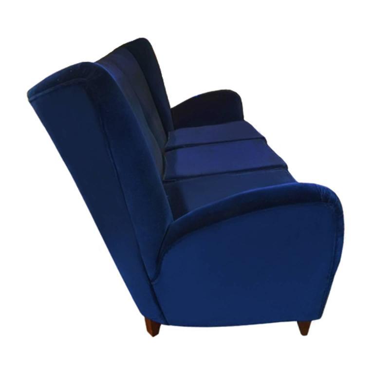 1960s Italian three-seat sofa in navy blue velvet upholstery by Paolo Buffa.
