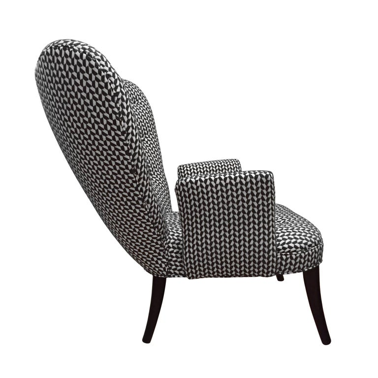 Flair Home collection custom Paolo chair in a black and white textured twill upholstery. Based on the elegant lines of a 1950s Italian armchair.  Pair available, priced individually.