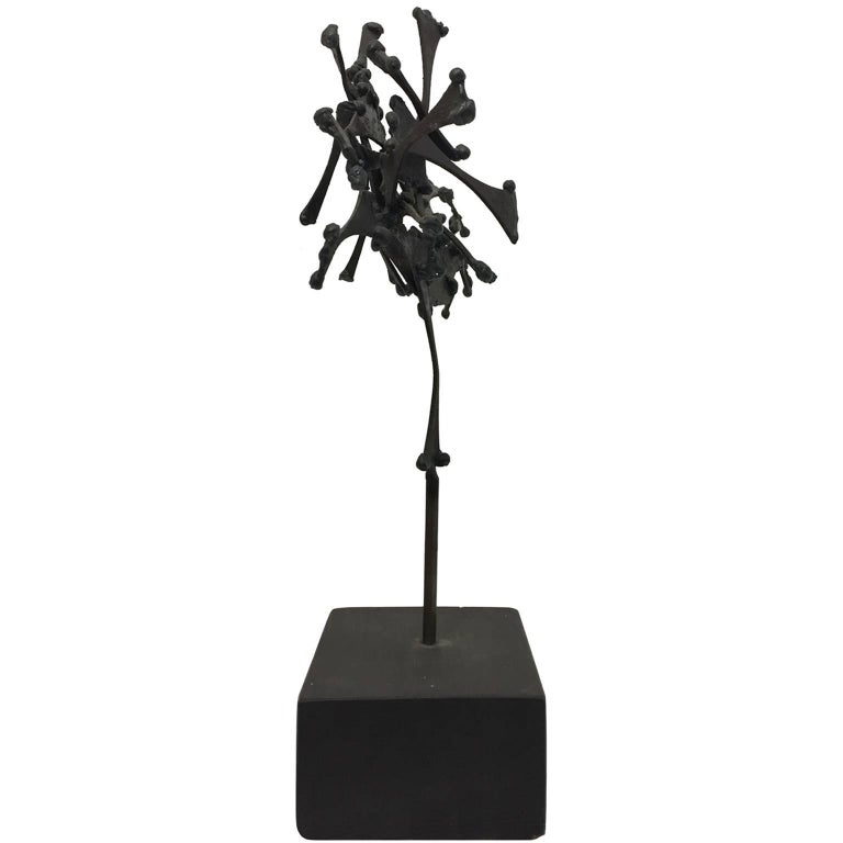 """Symbol IV"" abstract Brutalist metal sculpture on wood block base by John Risley, USA, 1960s."