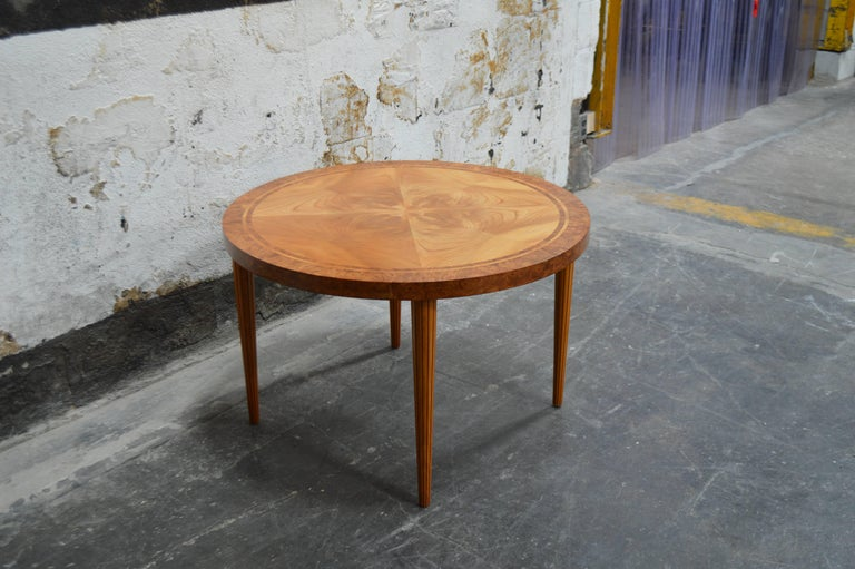 Swedish round golden elm end or side stable. Beautifully detailed with book matched top banded with Carpathian elm for additional interest. Atop tapered reeded legs. A very handsome table and perfectly scaled for any room.