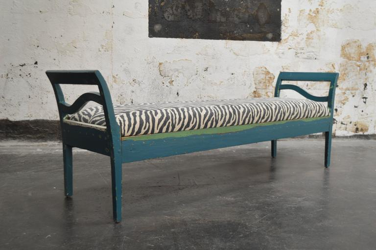 Restored Swedish Country settee, sofa or bench in the Gustavian Style. Probably late 19th century, but possibly earlier.    The top layer of teal paint has been partially distressed to reveal other layers of paint colors. All wood has been sealed