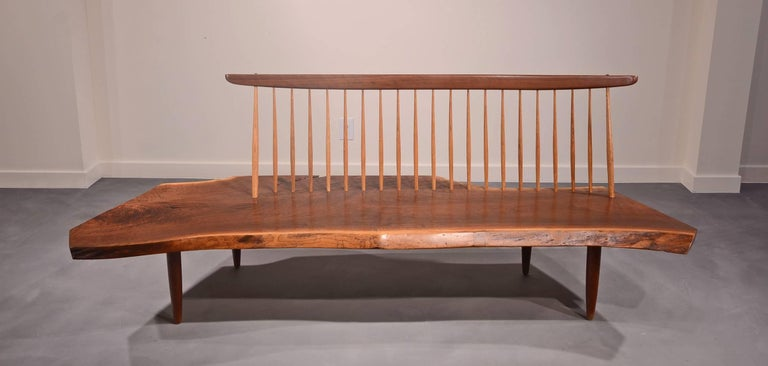 Walnut slab seat with Hickory spindles supporting walnut top rail.