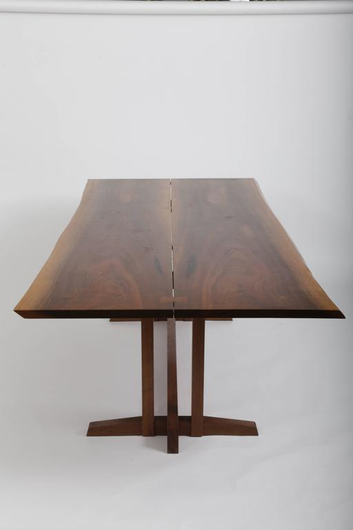 A wonderful bookmatched slabs of walnut joined by Walnut Butterflies,
