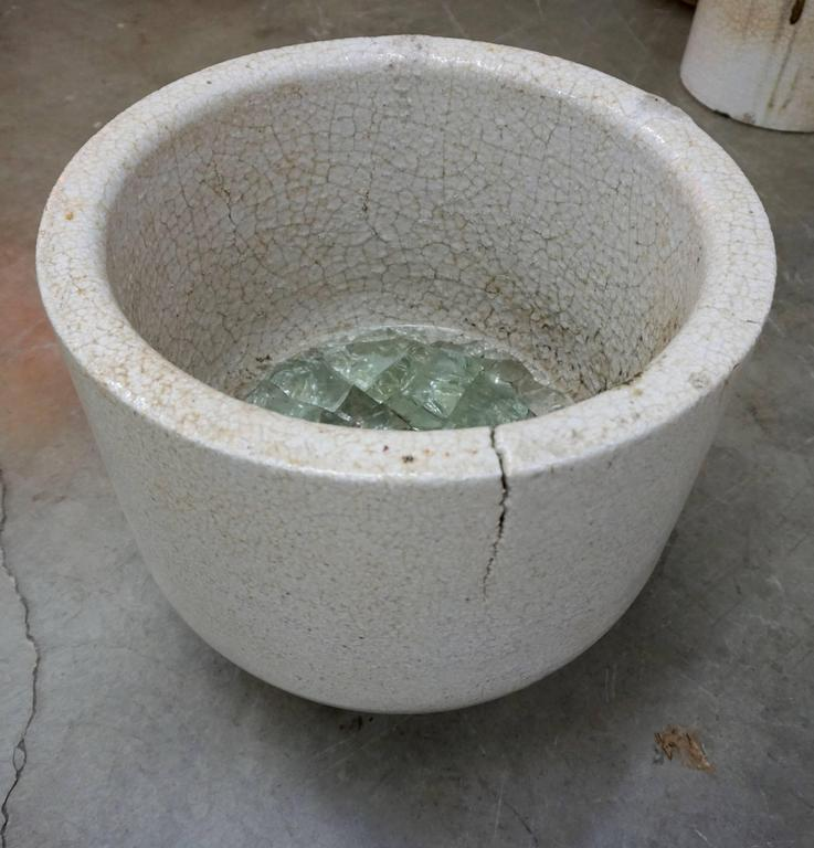 Ceramic vessel used by glaziers to melt glass at very high temperatures. Enhanced by the crackling, glass remnants and drippings. Can be used as a planter or decorative object, indoors or outdoors. Multiple crucibles available.