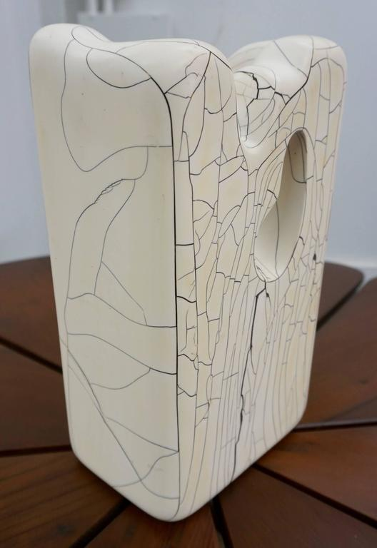 Crackled, polished finish with the look of marble. Interesting shape and form.