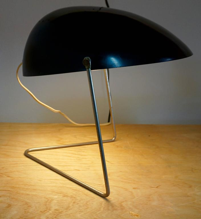 "Original Gerald Thurston for Lightolier black ""Cricket"" table lamp. Featuring