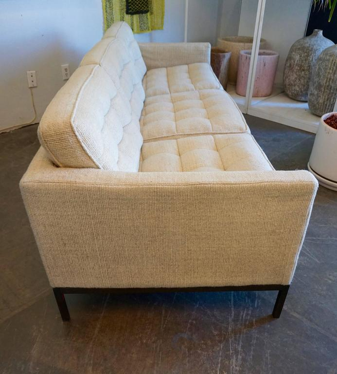 Timeless design, Knoll wool fabric, tufted and box stitched on a bronzed steel base.