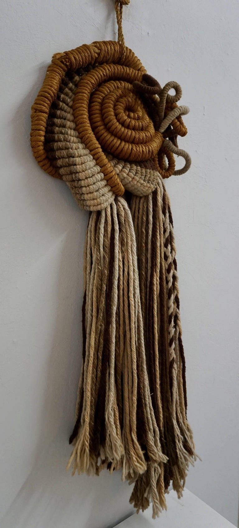 Unusual combination of rope, yarn and twine creating a very interesting wall hanging.