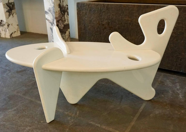 One off-white lacquered,abstract shaped coffee or side table.Designed with interlocking pieces of wood reminiscent of a Noguchi sculpture.