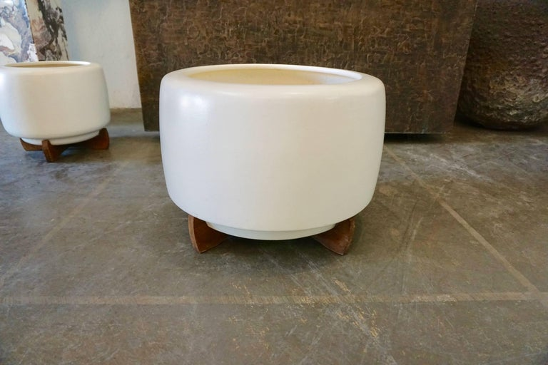 """Designed by Rex Goode and John Follis for Architectural Pottery. Bisque finished and mounted on original redwood stands, drilled for drainage. The larger one measures 13.5""""H x 17.5 diameter The smaller one measures 12""""H x 13"""" diameter with a small"""