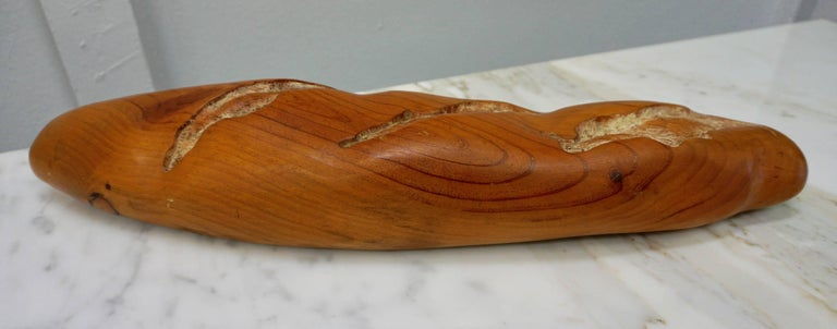 Carved and sculpted from a solid piece of wood by Laguna Beach artist, Rene Megroz. I also have a raincoat and a purse by the same sculptor.