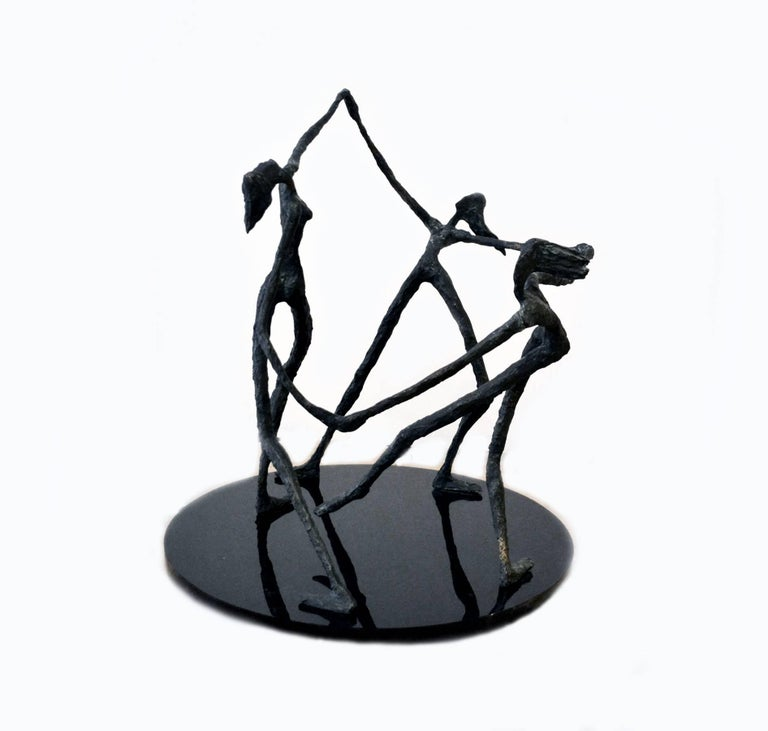 An exquisite vintage abstract bronze sculpture, circa 1940s-1950s, depicting three women dancing in a circle with arms joined, after renowned sculptor Alberto Giacometti. The bronze figures were forged with detail to movement, with hair blowing in