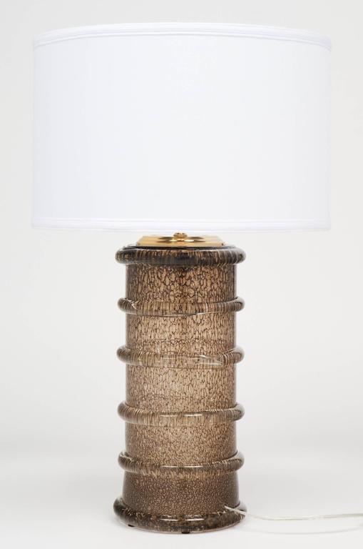 "Beautiful ribbed ""Pulegoso"" Murano glass table lamp. This rare modernist piece is a celebration of traditional techniques from the iconic glass blower combining within the thick smoked blown glass in fusion ; silver flecks (Avventurina) and oxygene"