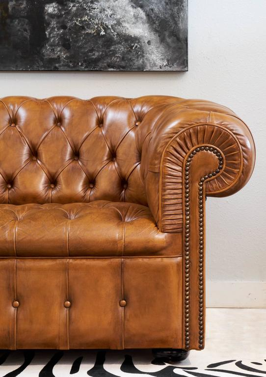 English Vintage Chesterfield Sofa In A Gorgeous Tufted Cognac Leather With Bronze Nail Heads And Ebonized