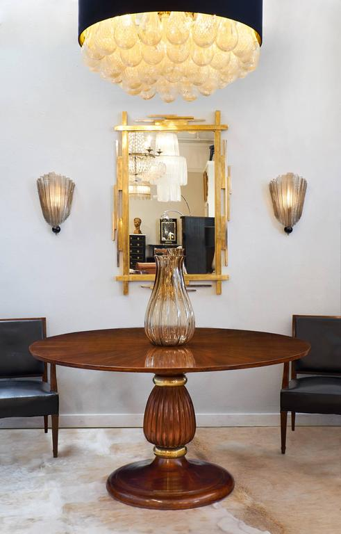 """Wonderful Mid-Century walnut table in the style of Paolo Buffa. This spectacular piece has a solid walnut base, two brass rings for balance, and a tulip foot with accentuated """"godrons."""" The top has stunning sun ray marquetry! This piece"""