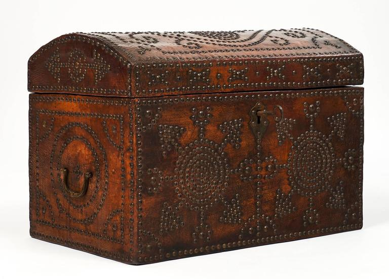 Large and wonderful French Napoleon III period leather box covered with leather and made of solid oak. This chest has intricate Renaissance patterns tooled in brass head tacks. The key and lock are original. Authenticity is added to the piece with