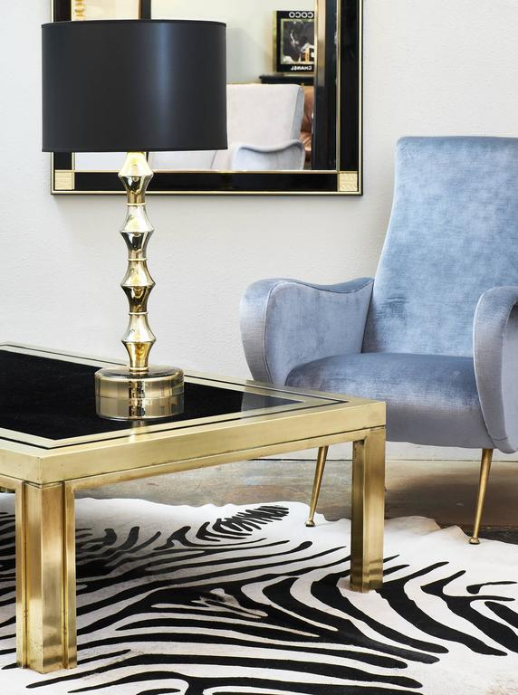 Spectacular French modernist coffee table by Pierre Cardin made of solid brass and with the original cobalt glass top.
