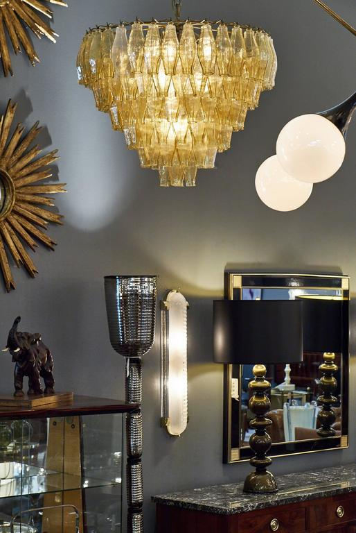 """Superb Murano glass chandelier made of many """"polyhedral"""" shaped components hanging from their original gilded steel frame. We love the reasonable size of this beautiful fixture and the incredible amber and gold hues of the glass. There are six tiers"""
