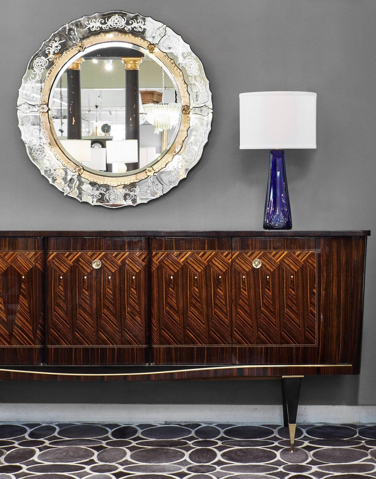 Impressive Mid-Century buffet from France made of Macassar of Ebony and inlaid with beautiful mother-of-pearl details. The facade of this buffet features geometric marquetry in a wonderful diamond pattern. The piece stands on tapered legs, and the