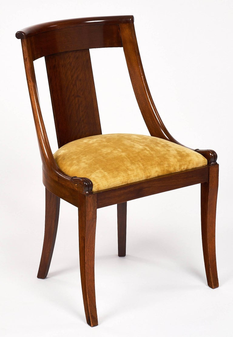 An elegant set of six French Empire gondola dining chairs made of solid Mahogany with a high luster French polish finish. These chairs have very strong frames with a nice seating angle. They are ready for the fabric of your choice! An identical set